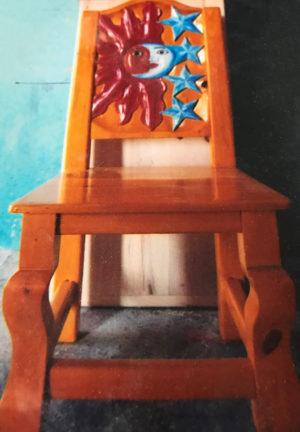 brown chair with sun moon stars