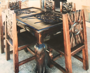dark wood face of sun dining room table and chairs