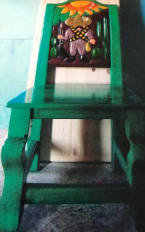 green chair revolutionary man