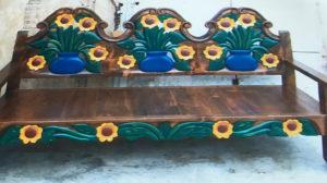 dark wood large bench blue vase sunflowers